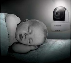 Baby sleeping with monitoring camera on.